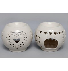 An assortment of sleek ceramic oil burners, each decorated with a heart cut decal