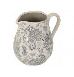 A stunning vintage floral jug with a blue/grey design and crackled grey finish.