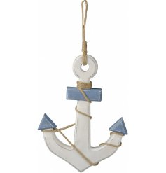 A small hanging wooden anchor decoration set with a distressed white and blue tone to it