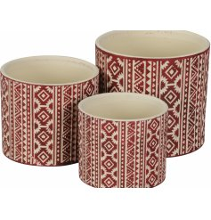 A set of 3 assorted sized ceramic pots, each featuring a trendy Moroccan inspired print to each