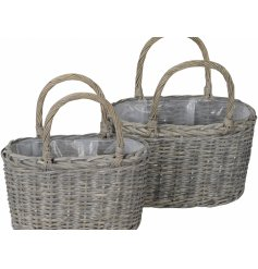 A charming set of assorted sized woven wicker basket planters