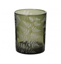 A stunning glass candle holder in green. Complete with a white fern decal. A stylish, on trend interior accessory.