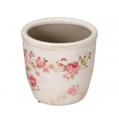 A rustic cream planter with a pretty pink rose design.