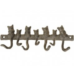 A cast iron hook unit with an added feline charm to it
