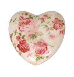 A vintage inspired decorative heart ornament with a pretty rose design.