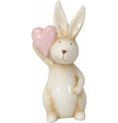 A shabby chic inspired ceramic bunny ornament with a pretty in pink polka dot heart.