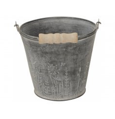 A stunning rustic metal bucket with a wild garden etched design.
