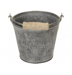 A rustic metal bucket with a wild garden design. Complete with a washed finish and vintage inspired wooden handle.