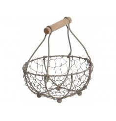 A rustic wire basket with a wooden handle. A charming storage item for the home and kitchen.