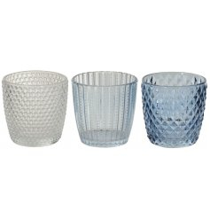 A mix of 3 glass patterned t-light holders/vases. Richly coloured in classic blue and clear hues.