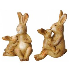 A mix of 2 kiss and cuddle bunny ornaments. A unique interior accessory with beautiful detailing.