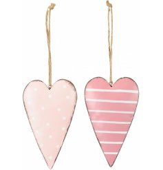 A mix of 2 hanging metal hearts, each with a distressed finish.