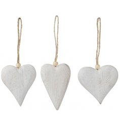 A mix of 3 natural white washed wooden hangers in assorted heart designs.