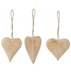 A mix of natural heart shaped hangers. Each has a visible wood grain and is complete with a beaded jute hanger.