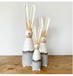A charming ceramic bunny with a rustic finish. Complete with a chic stripe outfit and pointed ears.