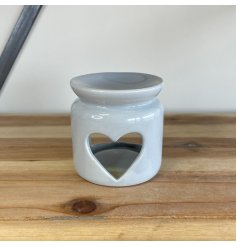 Burn your favourite oils in this attractive ceramic oil burner, complete with a heart cut out design.