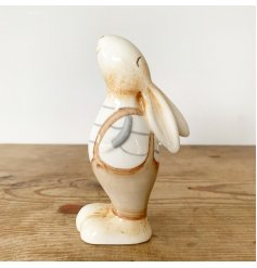Fall in love with this charming bunny decoration. Dressed in adorable dungarees with a rustic finish.