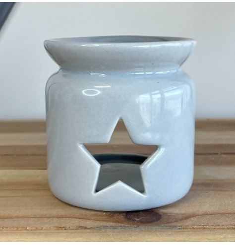 A chic and simple grey toned oil burner with a star cut central window