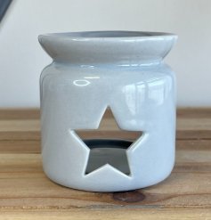 A small and simple grey toned ceramic oil burner with a star cut window