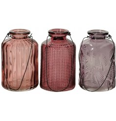 An assortment of beautifully decorative glass bottles in a mix of pink hues. Complete with wire handle.