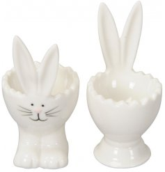 An assortment of 2 bunny egg cups. Each has pointed ears and an adorable painted face.