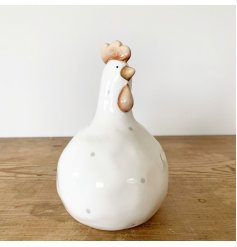 A rustic living chicken ornament with a beautifully crafted finish. With grey polkadots this product is full of charm