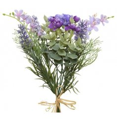 A beautiful artificial flower bunch with a mix of purple flowers. Bound with a rustic raffia bow.
