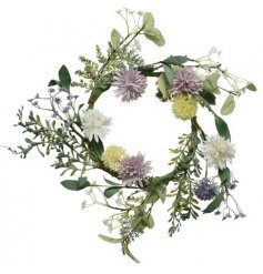 A wonderful and whimsical wreath decorated with purple and pink wild garden flowers and foliage
