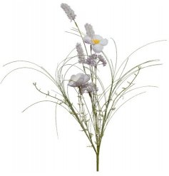 A pretty wild flower bunch in lilac hues. A fine quality artificial flower with foliage.