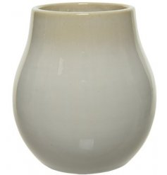 A chic and elegant handmade vase with a shiny pearl finish.