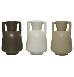 A mix of 3 brown, natural and white earthenware vases. Each is handmade and has a simple yet chic shape.