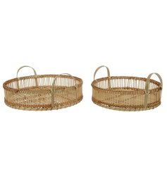 A set of 2 natural bamboo trays with handles. A simplistic, on trend design.