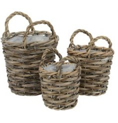 A set of 3 fully lined woven baskets with handles. A rustic living item with plenty of character and charm.