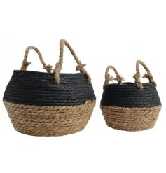 A set of 2 black and natural woven baskets, complete with chunky rope handles.