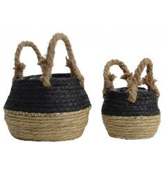 A set of 2 black and natural woven grass baskets. Complete with chunky rope handles and lining.