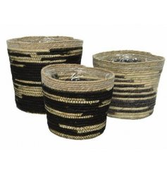 A set of 3 jute planters in a contemporary black and natural design.