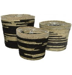 A set of 3 lined woven planters in black and natural colours.