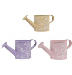 An assortment of 3 pretty pastel coloured watering cans, each with a delicate white floral design.