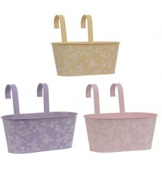 An assortment of 3 pretty pastel coloured troughs with a delicate white floral design.