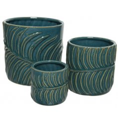 A stoneware based set of planters in a luxe emerald green tone and complete with an off toned embossed leaf decal