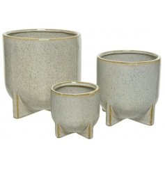A set of 3 beautifully glazed stoneware planters with geometric feet and a speckled finish.