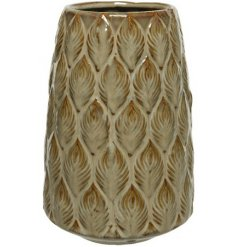 A beautifully glazed stoneware vase with an attractive leaf design.