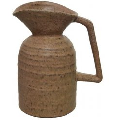 A rustic stoneware jug with plenty of character and charm. Complete with a square handle and curved spout.