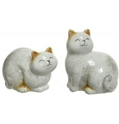 A mix of sitting cat ornaments, made from terracotta
