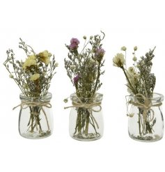 An assortment of Spring Inspired Floral bunches in glass jars