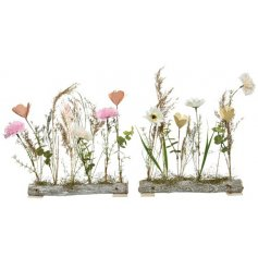 A mix of 2 dried flowers set upon a rustic wooden base. Creating your own wild garden at home