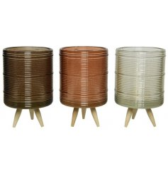 An assortment of 3 contemporary and cool glass t-light holders with a ribbed finish.