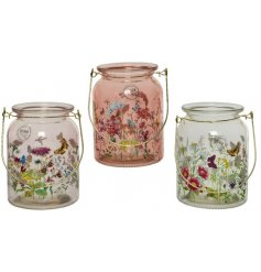 A mix of 3 wild flower hurricane lanterns. Each decal is bright and beautiful, featuring an array of flowers.