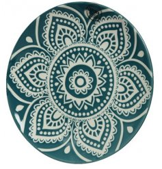 A beautiful emerald green porcelain dinner plate with a bold and beautiful mosaic design.