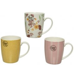 A mix of 3 pink and yellow porcelain mugs in a variety of bold and beautiful floral and dotty designs.